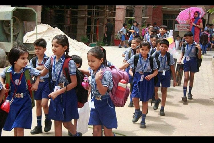 SHRC seeks report from TS and AP govt on weight of school bags and homework given