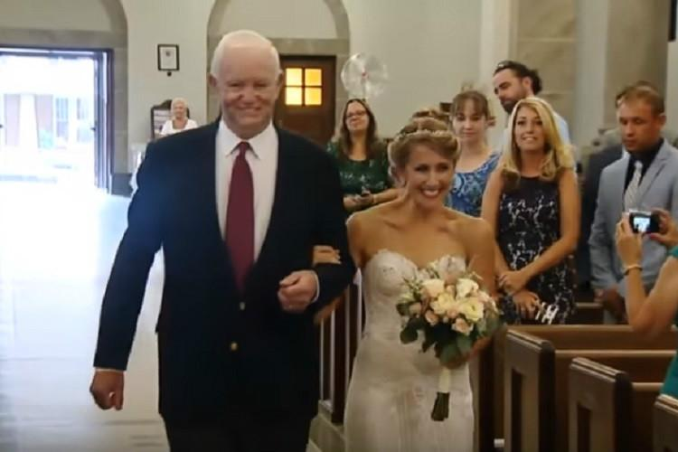 Watch American bride is given away at her wedding by man who got her fathers heart