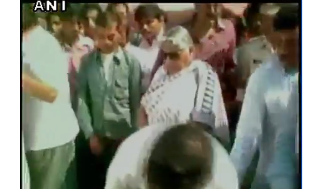 Peak insensitivity MP Minister kicks away a boy who came seeking alms
