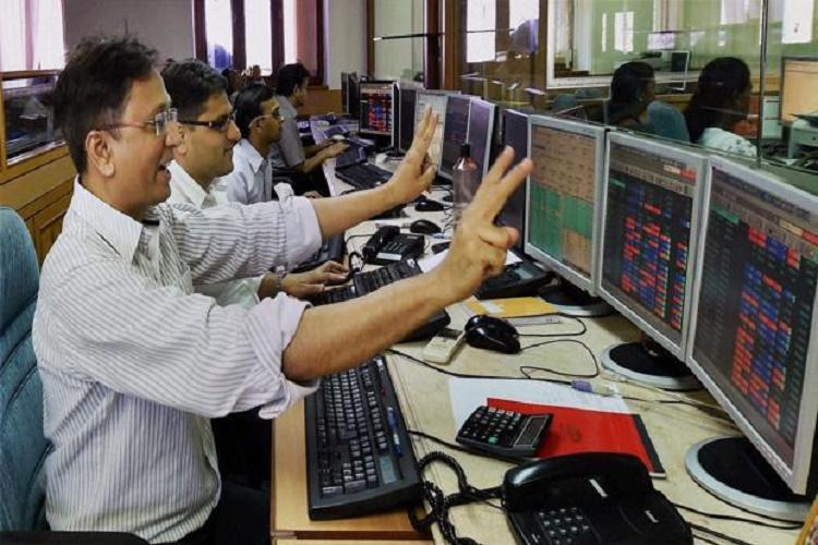 Sensex rallies over 900 pts in opening session Nifty crosses 9800