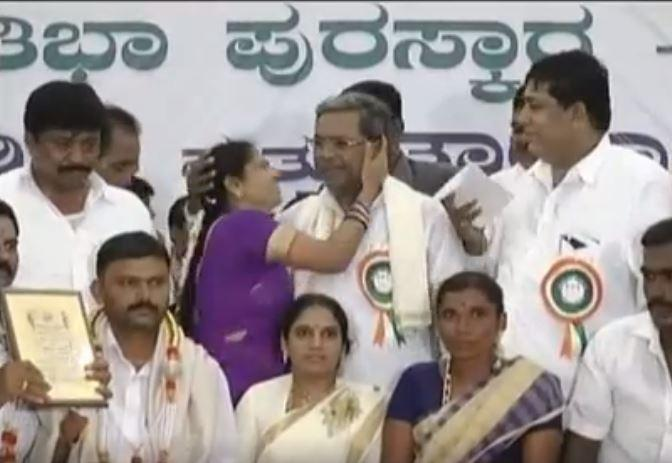 How a harmless peck on cheek turned into free for all to target Siddaramaiah