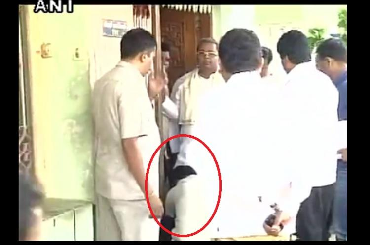 Controversy erupts over video showing a man tying Karnataka CMs shoelaces for him
