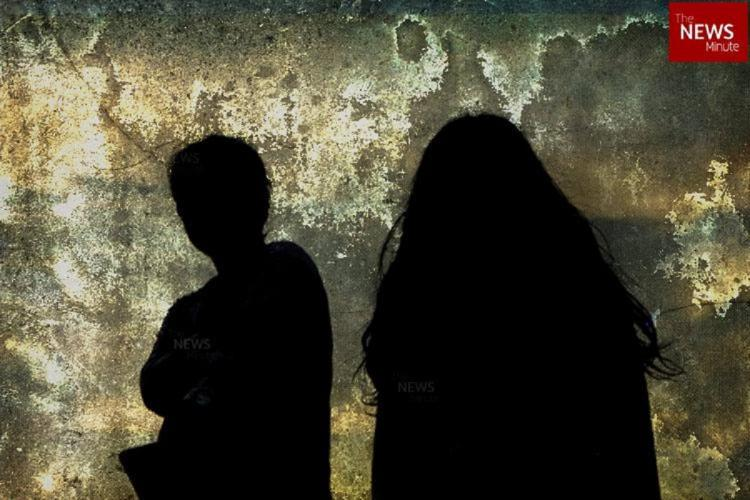 Two shadows of girls against a grey background