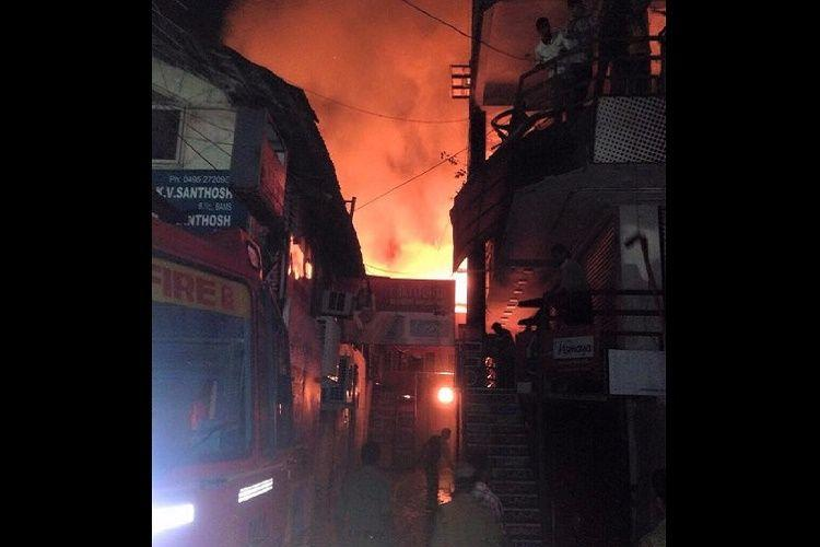 Many shops gutted in major fire at Kozhikode Sweet Market street no casualties reported