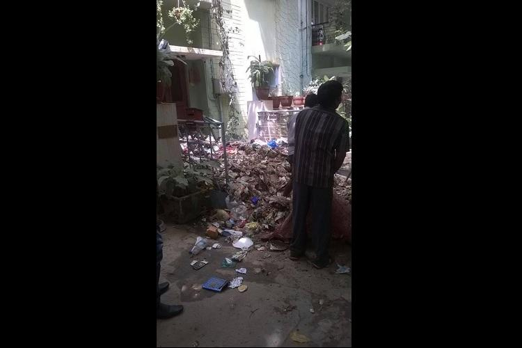 Irked sanitary workers dump garbage outside Bluru residents home outrage ensues online