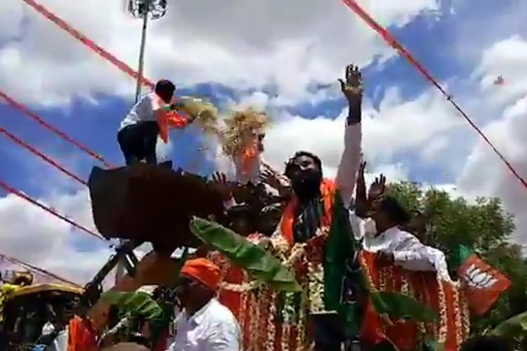 Ktaka Health Min Sriramulu takes part in large procession without mask distancing