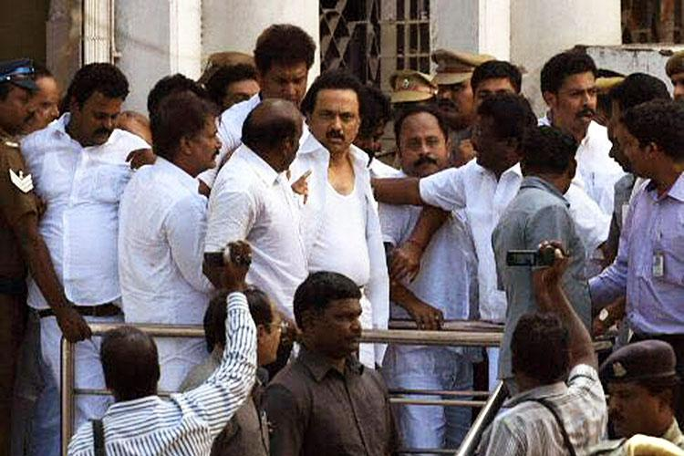 DMKs surprise drama at TN Assembly Evicted MLAs complain to Governor protest at Marina