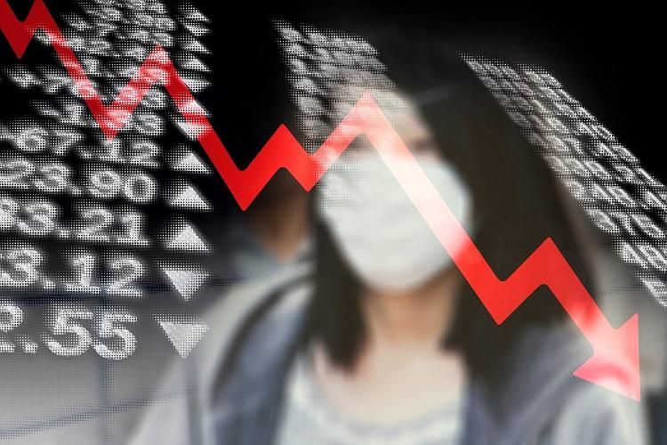 Stock exchange numbers against a woman wearing a mask with a red arrow trending downwards superimposed on it