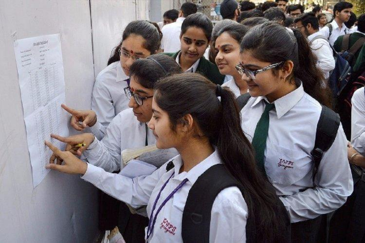 Students checking results in India