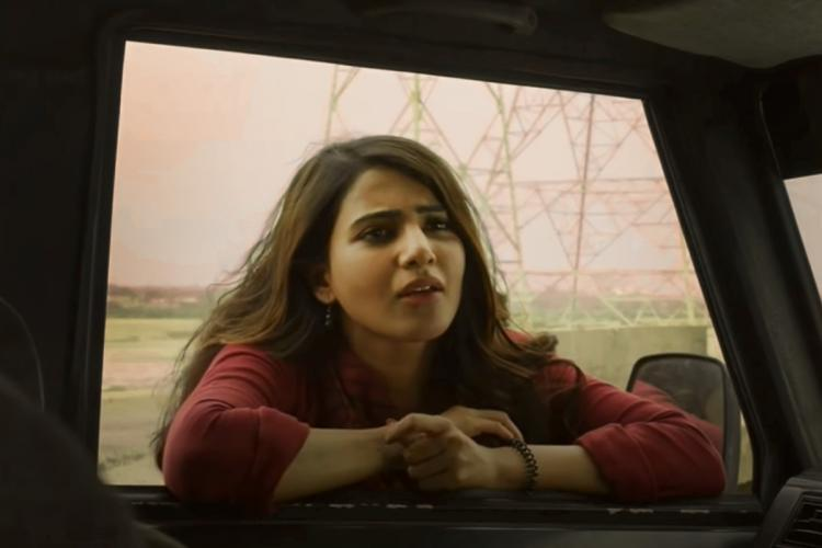 Samantha as Vaembu in a maroon top with loose hair from Super Deluxe film staring at the camera