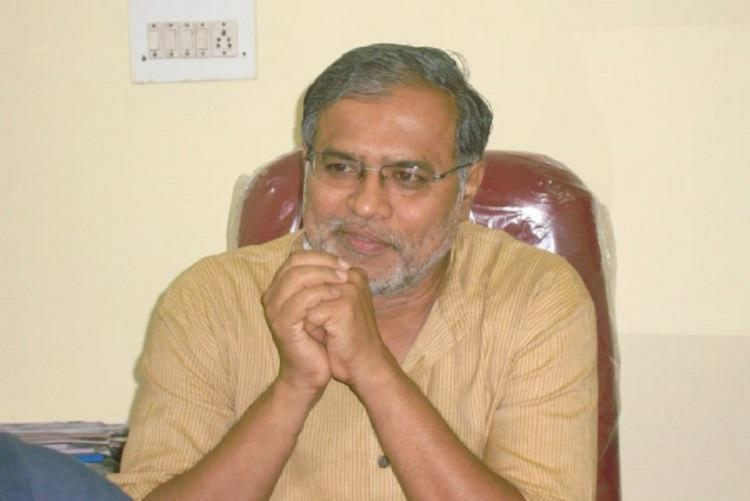 Karnataka Education Minister S Suresh Kumar seated in his chair