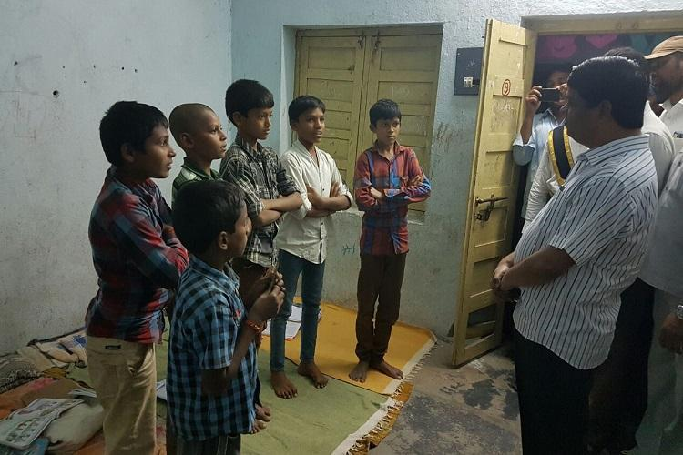 Telangana officials walk the talk spend night at govt hostel to understand kids woes