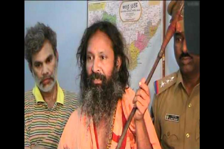 Kashi Maths Swami Raghavendra who absconded with antique idols brought before Ernakulam CJM