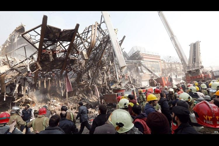 At least 30 fire fighters killed as Tehrans oldest trade tower collapses in blaze