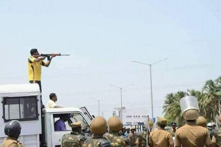 A person stands on the top of a vehicle to shot protesters against the Sterlite plant in Thoothukudi in May 2018