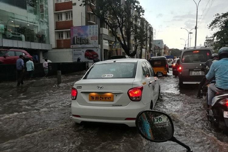 In pictures Heavy rains bring flooded roads traffic jams to Chennai