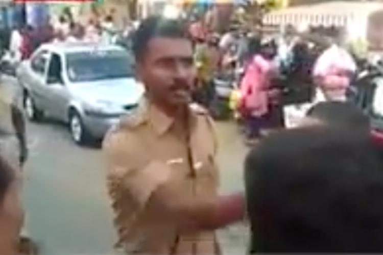 Watch TN cop stands up to protesters threatening to damage bus during Kerala hartal