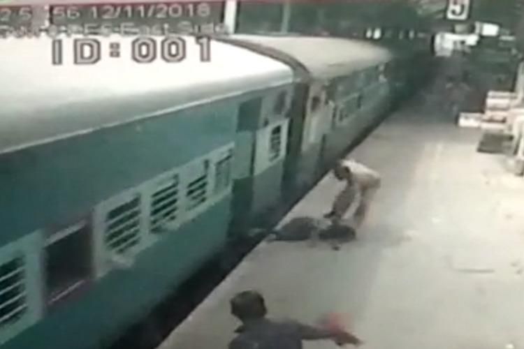 Video RPF cop saves Chennai man as he slips and falls under moving train