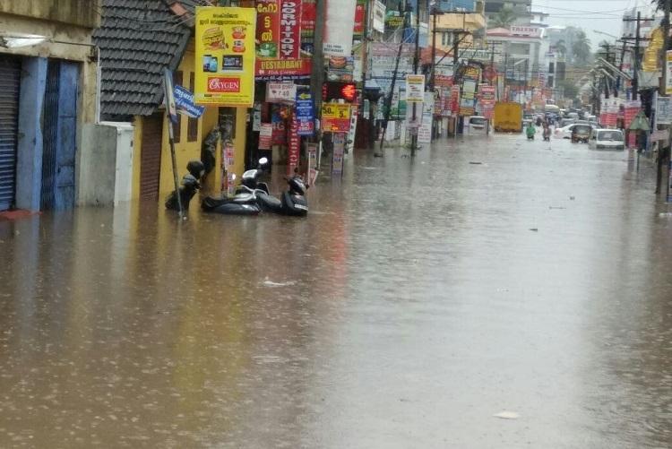 Rain lashes Kerala capital Thiruvananthapuram wades through knee deep water