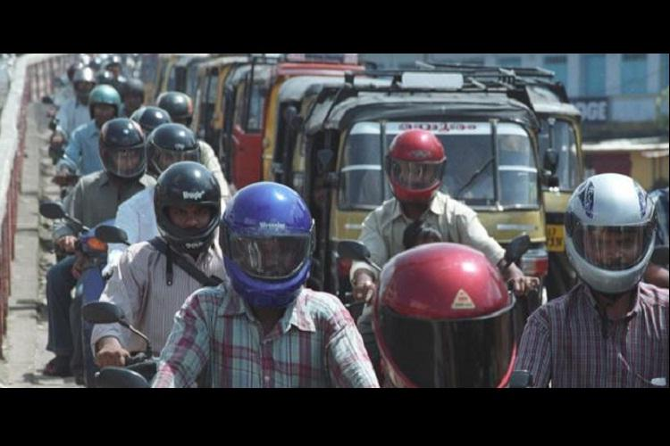 Kerala Transport Commissioner relaxes no helmet no petrol rule opts for awareness campaign