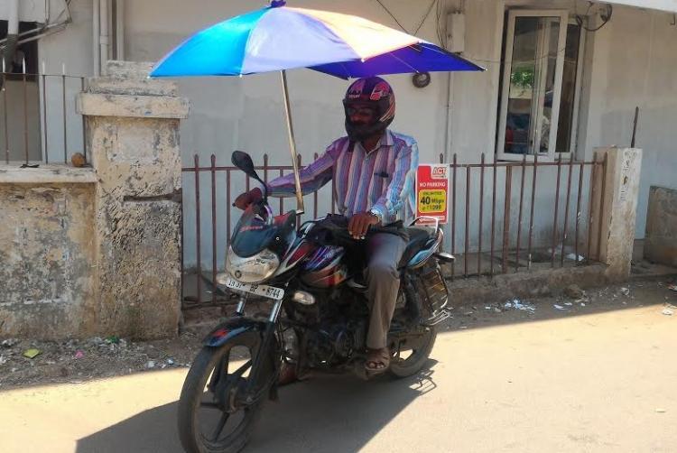 The Umbrella Man Coimbatoreans over-head bike gear to your summer rescue
