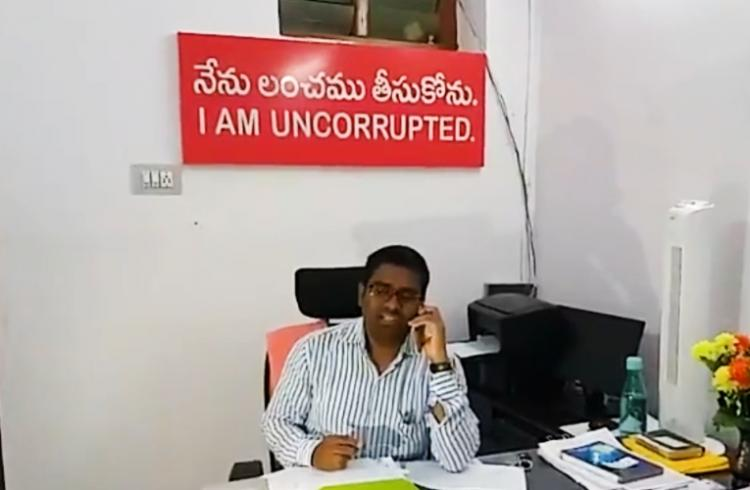 Tired of bribe offers Telangana official puts up I dont take bribes board
