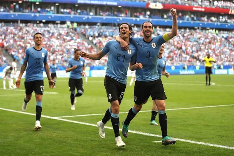 World Cup Uruguay beat Russia 3-0 to top Group A
