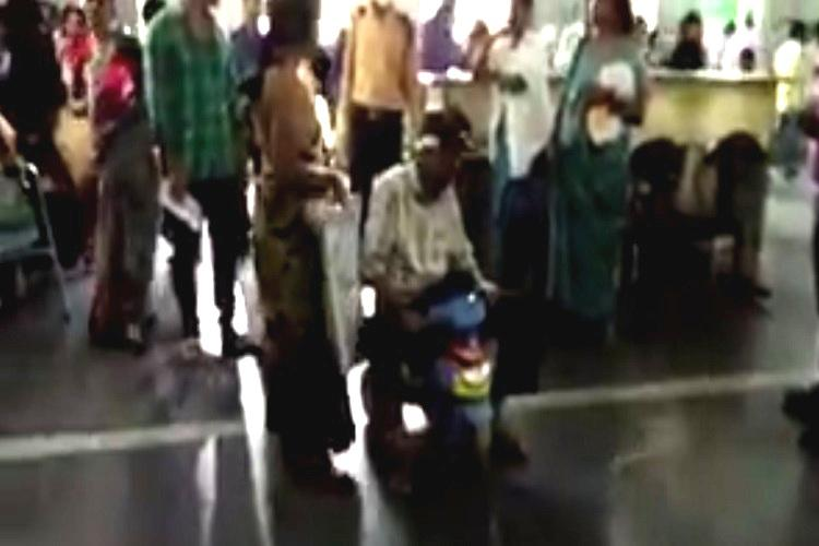 Video Unable to pay bribe for wheelchair Hyd man moves around hospital in sons toy tricycle