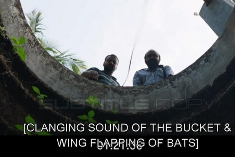 Two men look into an open well and the shot is from the bottom and English subtitles are visible