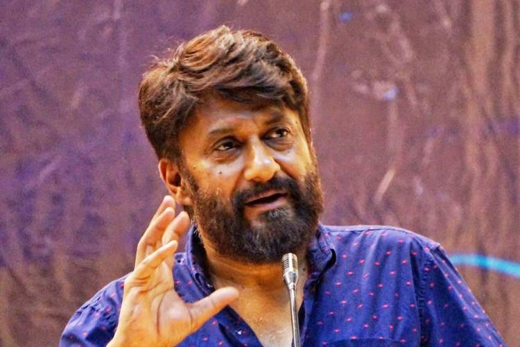 Indian filmmaker Vivek Agnihotri wearing a blue shirt and speaking at an event