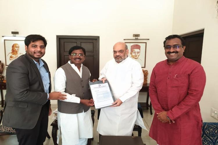 Former Congress and TRS MP Vivekanand meets Amit Shah hints at joining BJP