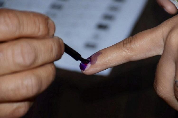 Election image of ink applying to a voters finger