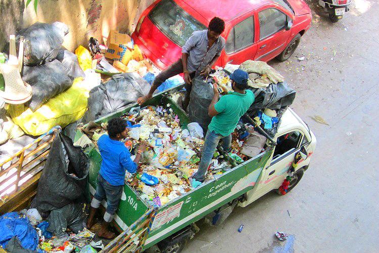 No gloves or masks Hyderabad waste pickers segregate waste by hand despite GHMC initiative