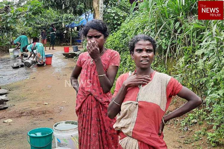 Women fetching water in wayanad koovana colony