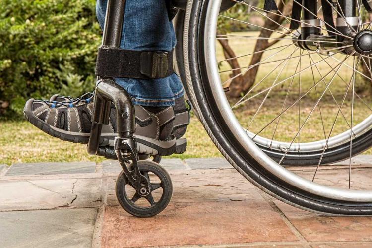 A persons legs in a wheelchair