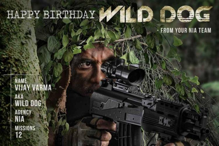 Nagarjuna in camouflage holding a rifle on the poster of Wild Dog