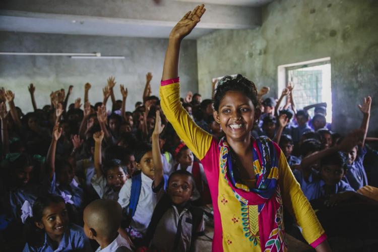 Woman leader of Bandhan Mukti a survivors collective posing after a school sensitisation workshop