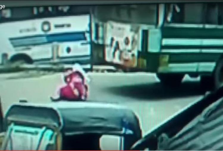 CCTV footage shows woman falling through moving bus as floor gives away