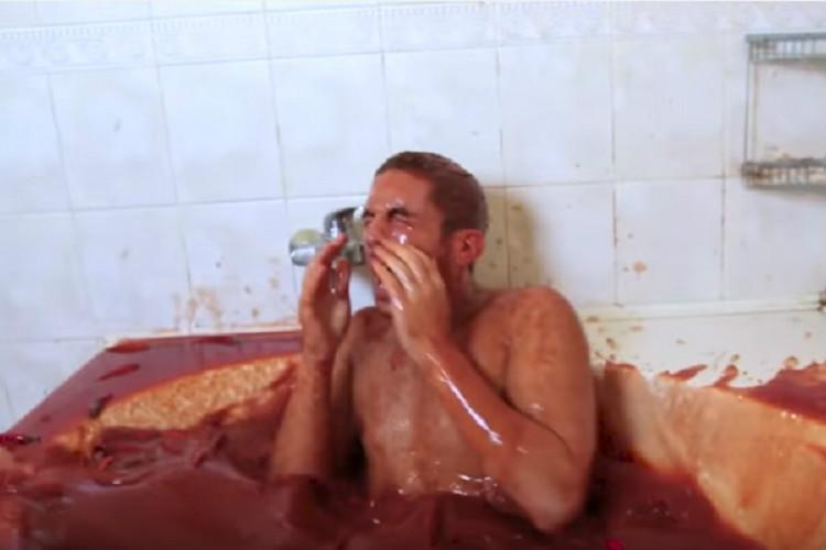 Video This guy found out what happens when you plunge into a tub of hot sauce