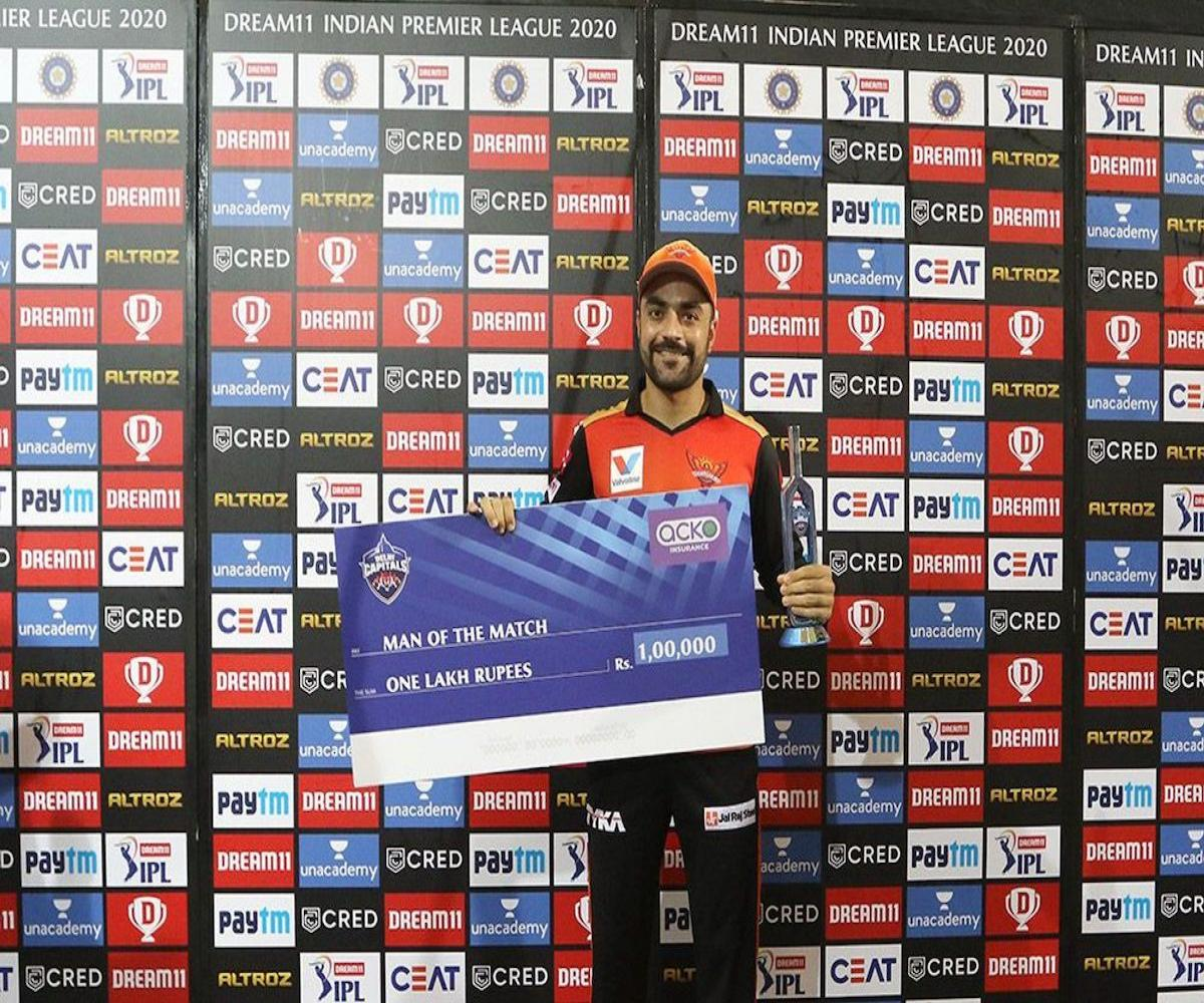 Rashid Khan receives the man of the match award for his performance against DC.