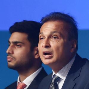 Anil Ambani and his son Anmol Ambani at a Reliance AGM