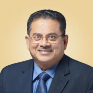 A portrait of George Muthoot
