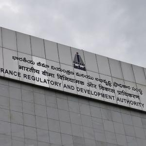 Grey sign board of the IRDAI against a grey sky