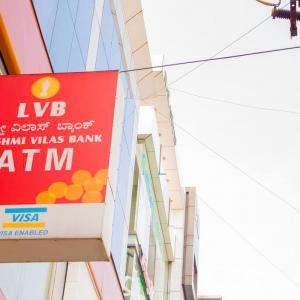A signboard showing the name and logo of Lakshmi Vilas Bank