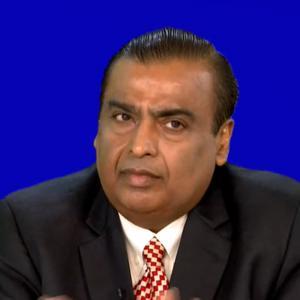 RIL Chairman Mukesh Ambani in black suit