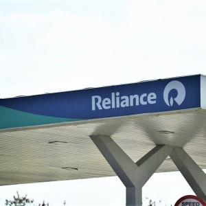 reliance petrol filling station, logo and name on board