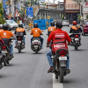Swiggy and Zomato workers riding, photo taken from the back