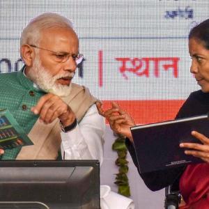 PM Narendra Modi and FM Nirmala Sitharaman during an event