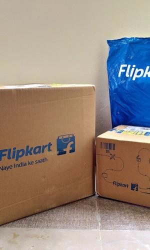 Two Flipkart boxes and one package, with the logo on the packages