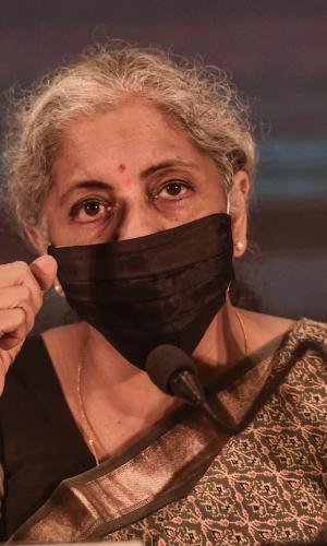 Finance Minister Nirmala Sitharaman close up, wearing a black mask and speaking at an event